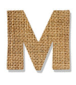 "The letter ""M"" is made of coarse cloth. — Stock Photo"