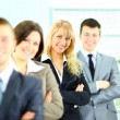 Young businesswoman with her colleagues — Stock Photo