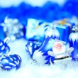 Stock Photo: Festive decorations with gift boxes on snow