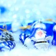 Festive decorations with gift boxes on snow — Stock Photo
