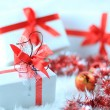Christmas gift boxes with red ribbon — Stock Photo