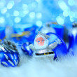 Colorful blue christmas decorations on white snow — Stock Photo