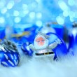 Colorful blue christmas decorations on white snow — Stock Photo #8016612