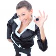 Top view of a happy young business woman making ok sign — Stock Photo #8084985