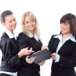 Portrait of three beautiful businesswomen discuss — Stock Photo #8136322