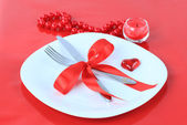 Romantic Dinner on red background — Stock Photo