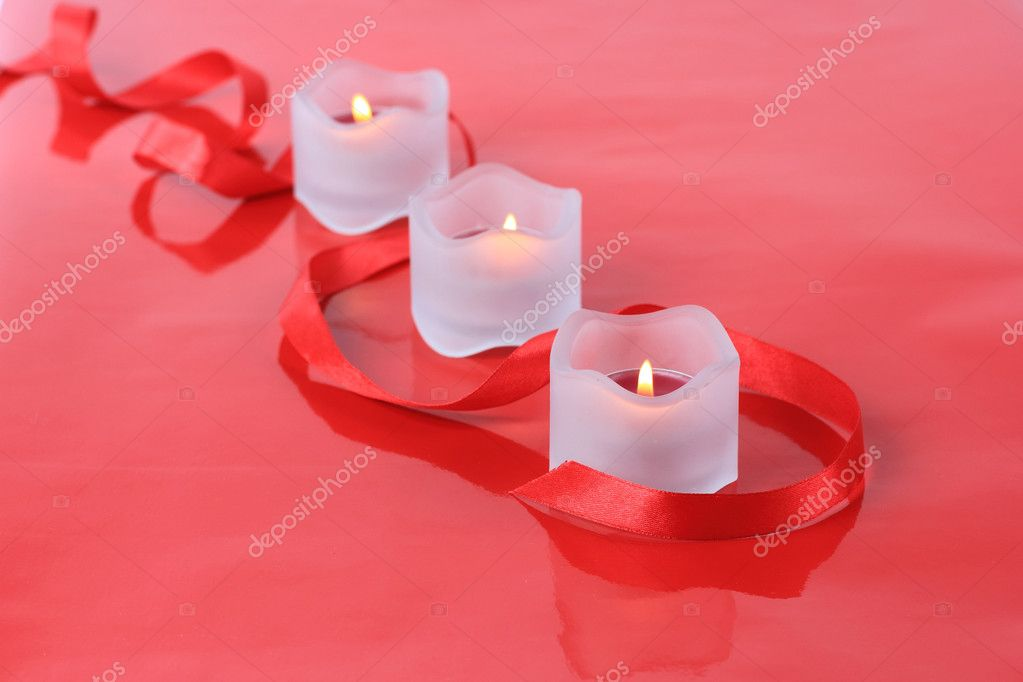 Close-up of valentine candles with ribbon isolated on  red background — Stock Photo #8419883