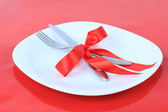 Romantic Dinner on red background. Place setting for Valentine's — Stock Photo