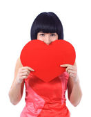 Woman hiding behind a red heart, isolated on white — Stock Photo