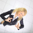 Top view of confident young businesswoman showing OK sign in her office — Stock Photo