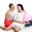 Young romantic valentine's couple with hearts balloons — Stock Photo