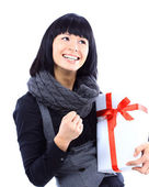 Beautiful business woman holding a gift isolated on white — Stock Photo
