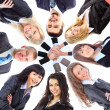 Group of business standing in huddle, smiling, low angle view — Stock Photo #8875496