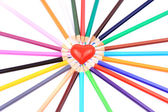 Colored pencils around heart - isolated on the white background — Stock Photo