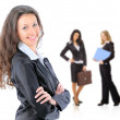 Female Business leader standing in front of her team — Stock Photo
