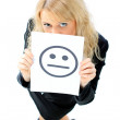 A beautiful young business woman hiding behind a smiley face — Stock Photo