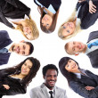 Group of business standing in huddle, smiling, low angle view — Stock Photo #9022891