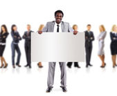 African business man and group holding a banner ad, full length portrait isolated on white background. — Stock Photo