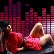Stock Photo: Sexy lady, lying on table, on disco background