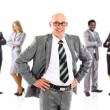 Male Businessman leader standing in front of his team — Stock Photo