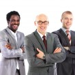 Leader and his business team formed of young businessmen standing — Stock Photo