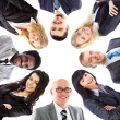 Group of business standing in huddle, smiling, low angle view — Stock Photo #9453192