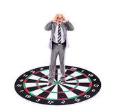 Businessman placed on a dartboard — Stock Photo