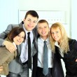 Happy smiling business team of young businessman and businesswoman in office — Stock Photo