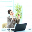 Portrait of happy business woman on phone call at office — Stock Photo #9736699