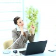 Portrait of happy business woman on phone call at office — Stock Photo