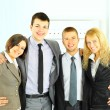 Stock Photo: Happy smiling business team of young businessman and businesswoman in office