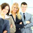 Close up portrait of young businesswoman with her collegues on background — Stock Photo #9999101