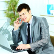 Smart business man using laptop in modern office — Stock Photo