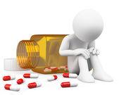 3D depressed man taking pills — Stock Photo