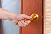 Hand and the door handle — Stock Photo