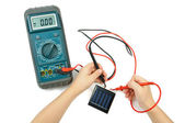 Electronic tester and solar battery — Stock Photo