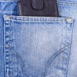 Wallet in the pocket of jeans — Stock Photo