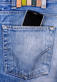 Mobile phone in your pocket jeans — Stock Photo