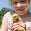 Little girl with a duck — Stock Photo