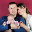 Lucky making look younger family with breast child - Stockfoto