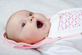 Small breast child yawns — Stock fotografie