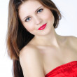 Portrait bright beautiful girl with long hair in red — Stock Photo #10410229