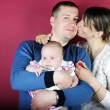 Lucky making look younger family with breast child — Stock Photo #10454488
