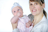 Lucky making look younger mother with breast child — Stock Photo