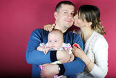Lucky making look younger family with breast child — Stock Photo