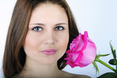 Portrait of the beautiful girl with scarlet rose — Stock Photo