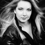 Beautiful girl blonde in black shirt — Stock Photo #10552096
