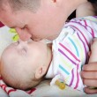 Young father kisses small daughter — Stock Photo #10553956