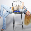 Beautiful girl blonde with long hair in jeans suit — Stock Photo #10554954
