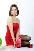 Bright beautiful girl in red gown — Stock Photo